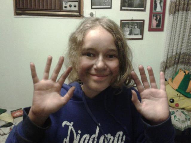 My beautiful daughtr Annelise showing her dirty hands from drawing with charcoal