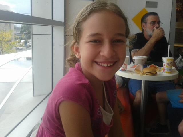 My beautiful daughter Annelise eating at a fast food restaurant
