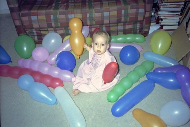 My beautiful daughter Annelise playing with coloured balloons at her first birthday party